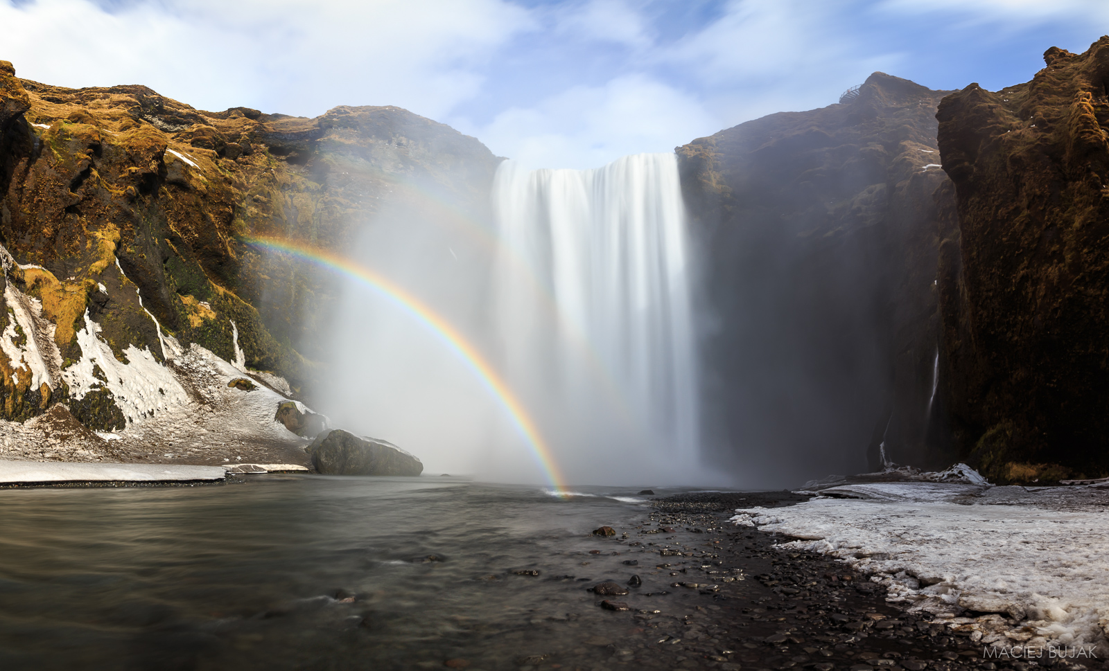 Rainbow over Skógafoss waterfall, Iceland